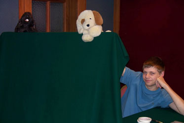 Our son Andrew and two puppets: Denali and Shou-O