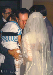 Uncle Joe hugging Vivian at our wedding.