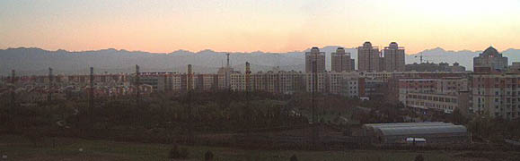 Though we moved to Xi'an in Aug 2002, the first time we ever saw the mountains was November 2002! This was the rare but amazing sight, looking south from our 2002 apartment roof.